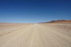 Gravel Road into Desert. A straight gravel road into the namib desert royalty free stock photography