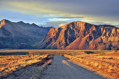The gravel road between the endless pampas Royalty Free Stock Images