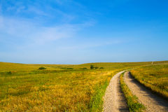 Gravel Road through Flint Hills. Country Road leading through the Flint Hills of Kansas Stock Image