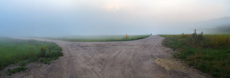 Gravel road in the fog Royalty Free Stock Photography