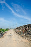 Gravel road full of garbage. Stock Photography