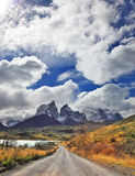 The gravel road goes to the cliffs of Los Kuernos. Royalty Free Stock Images