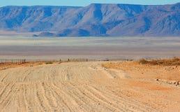 Gravel road through the golden dune royalty free stock image