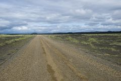 Gravel road in Iceland. Trough cold volcanic desert Royalty Free Stock Photography