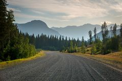 Gravel road in Kananaskis Country with haze from forest fires in. Gravel road in Kananaskis Country, Alberta with haze from forest fires in the air Stock Images