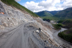 Gravel road Kolyma to Magadan highway at Yakutia Stock Photos