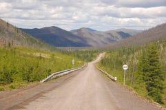 Gravel road Kolyma to Magadan highway at Yakutia Royalty Free Stock Image