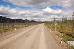 Gravel road Kolyma to Magadan highway at Yakutia. Russia Stock Photos
