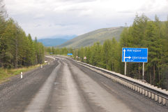 Gravel road Kolyma to Magadan highway at Yakutia. Russia Royalty Free Stock Image