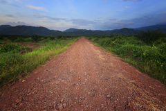Gravel road leading into hills Royalty Free Stock Images