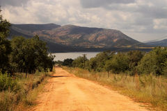 Gravel Road Leading to Dam Royalty Free Stock Photography