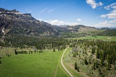 Dirt Road through Wyoming Wilderness Stock Image