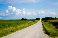 Gravel road in the midwest on a sunny day stock images