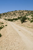 Gravel road in Morocco Royalty Free Stock Photography