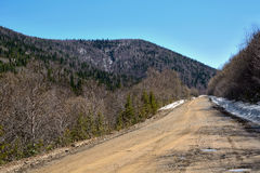 Gravel road on a mountain pass Royalty Free Stock Images