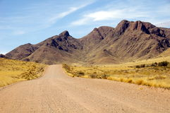 Gravel road in Namibia. A long scenic gravel road in Namibia Royalty Free Stock Photo