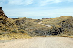 Gravel road in Namibia. A long scenic gravel road in Namibia Stock Image