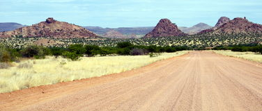 Gravel road in Namibia. A long scenic gravel road in Namibia Royalty Free Stock Photography