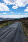 Gravel Road in Norway. With mountains in background Royalty Free Stock Image