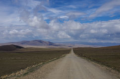 Gravel road in open spaces Royalty Free Stock Images