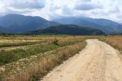 Gravel road. Romania, gravel road, the way to the  Fagaras highway Royalty Free Stock Photo