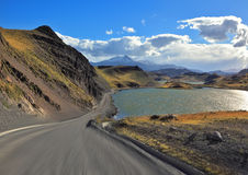 A gravel road runs by the lakeside Royalty Free Stock Photo