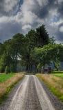 Gravel road in a rural landscape. Gravel road going through a old rural landscape stock image