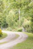 Gravel road in rural landscape, Sweden Stock Image