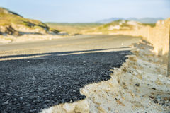 Road endings. Gravel road in South Africa undermined by sand Royalty Free Stock Image