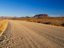 Gravel road and table mountain Royalty Free Stock Images