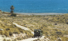 Gravel road to the beach with four wheel drive Royalty Free Stock Photos