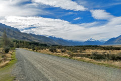 Gravel road to campsite at Glentanner Park Centre with Aoraki / Mount Cook seen in background.  royalty free stock image