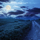Gravel road to high mountains at night Royalty Free Stock Photography