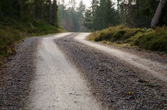 Gravel road at the top of a hill Stock Images