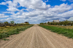 Gravel road. Under a blue sky with clouds Stock Photography