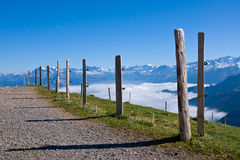 A gravel road up in the alps Stock Photography