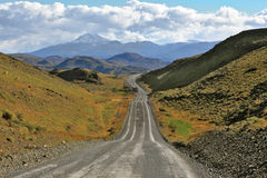 A gravel road winds among the hills Stock Image