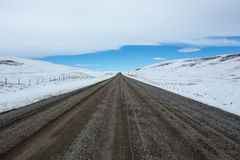 Gravel road and winter landscape Stock Photography