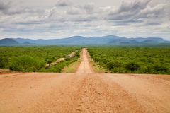 Gravel road with Zebra Mountains in Namibia Royalty Free Stock Image