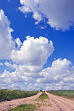Gravel Rural Road And Summer Sky Clouds Royalty Free Stock Image