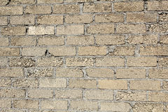 Gravel and sand bricks in a wall texture Stock Photography