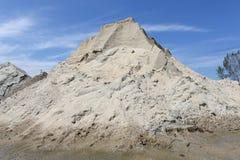 Gravel sand mound. Against blue sky Stock Photos