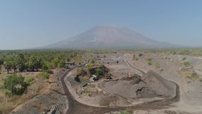 Gravel and sand quarry. Heavy machinery at gravel and sand quarry. excavator loads gravel truck, extraction volcanic sand at sorting crushing stock video
