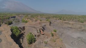 Gravel and sand quarry. Heavy machinery at gravel and sand quarry. excavator loads gravel truck, extraction volcanic sand at sorting crushing stock footage