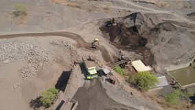Gravel and sand quarry. Heavy machinery at gravel and sand quarry. extraction volcanic sand at sorting crushing complex. rock crushing and stock video footage