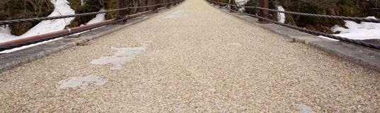 Gravel and sand texture on the walking bridge Stock Images
