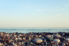 Gravel with sea background Royalty Free Stock Photos