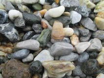 Wet pebbles shaped by water royalty free stock images