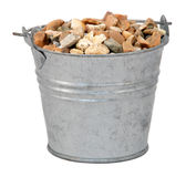 Gravel / small stones in a miniature metal bucket Stock Photo