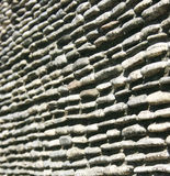 Gravel stone wall Stock Image